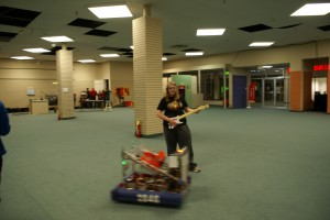 A team member controlling the robot with a guitar.