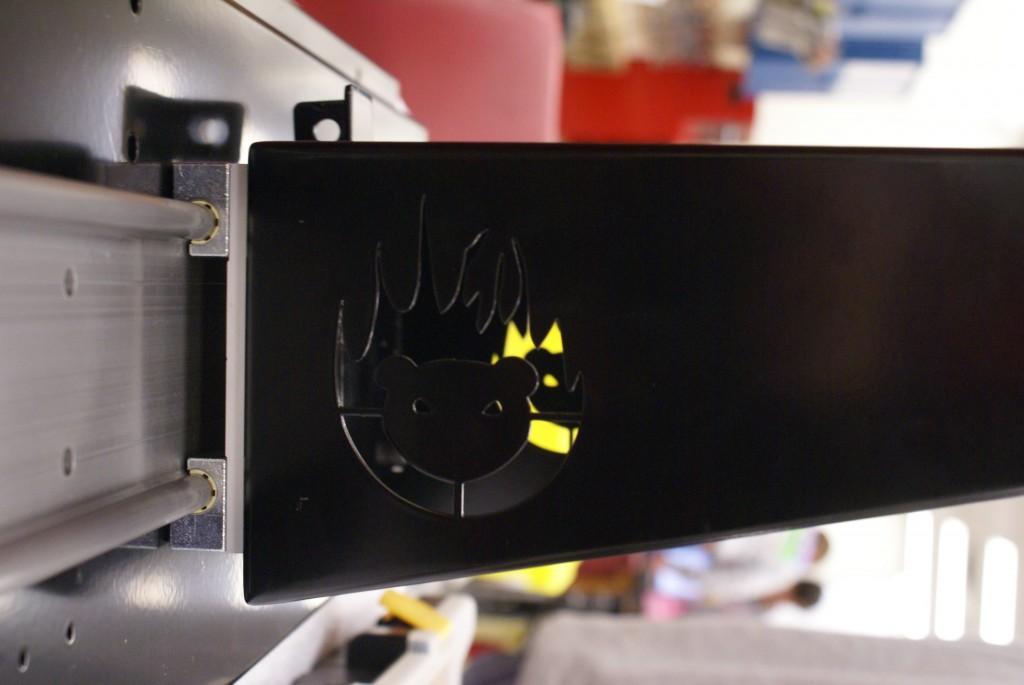 FireBear Logo (A Bear Head incased in flames) as a hole in a piece of black powdercoated metal